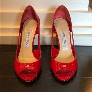 Jimmy Choo red patent leather open tie pump.